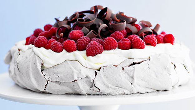 Pavlova Topped with Raspberries and Chocolate